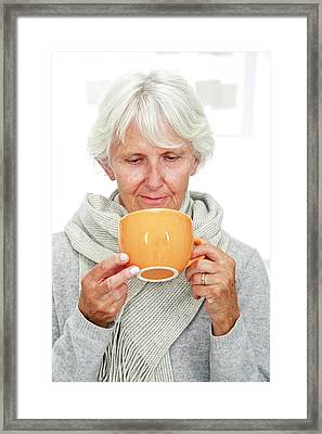 Elderly Woman With A Hot Drink Framed Print by Lea Paterson