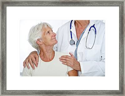 Elderly Woman With Doctor Framed Print by Lea Paterson