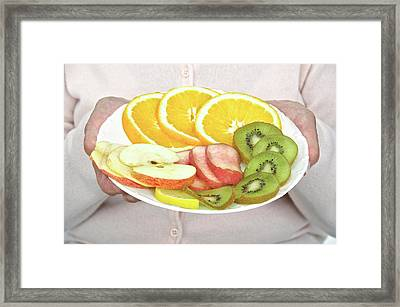 Elderly Woman With Fruit Framed Print