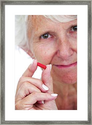 Elderly Woman With Medication Framed Print