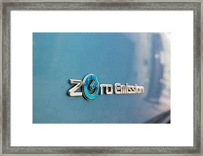 Electric Car At A Recharging Station Framed Print by Ashley Cooper