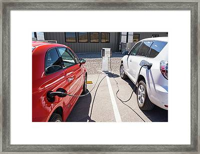 Electric Cars Being Recharged Framed Print by Ashley Cooper