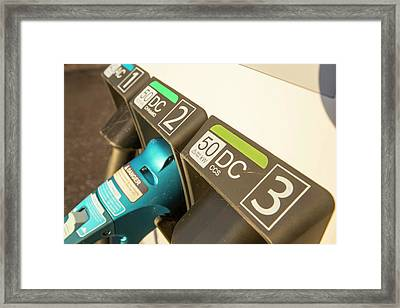 Electric Vehicle Recharging Station Framed Print by Ashley Cooper
