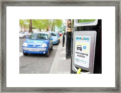 Electric Vehicles At Charging Stations Framed Print