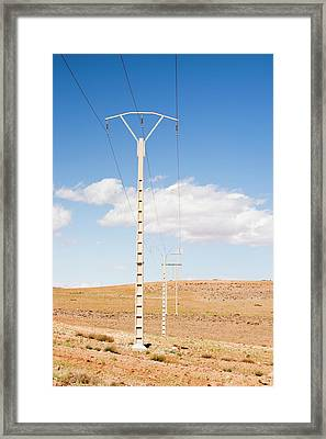 Electricity Pylons Framed Print by Ashley Cooper