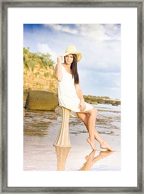 Elegant Woman With Hat Sitting At The Beach Framed Print by Jorgo Photography - Wall Art Gallery
