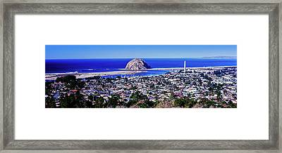 Elevated View Of City At Waterfront Framed Print