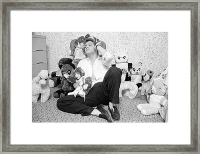 Elvis Presley At Home With Teddy Bears 1956 Framed Print by The Harrington Collection
