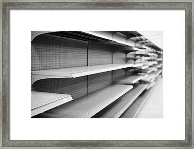 empty shelves in a store in Saskatoon saskatchewan canada Framed Print by Joe Fox