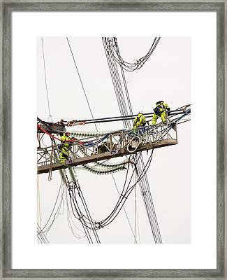 Engineers Working On Electricity Wires Framed Print by Ashley Cooper