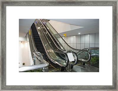 Escalators In A Museum Framed Print