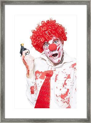 Evil Clown Holding Cap Gun On White Background Framed Print by Jorgo Photography - Wall Art Gallery