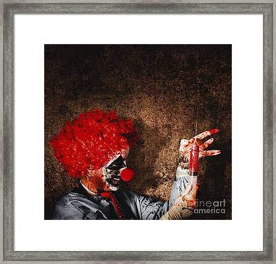 Evil Halloween Clown With Big Scary Needle Framed Print by Jorgo Photography - Wall Art Gallery