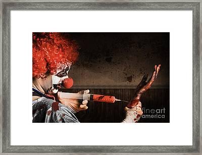Evil Healthcare Clown Holding Needle And Syringe Framed Print