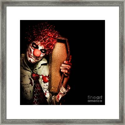 Evil Horrible Clown Holding Coffin In Darkness Framed Print by Jorgo Photography - Wall Art Gallery