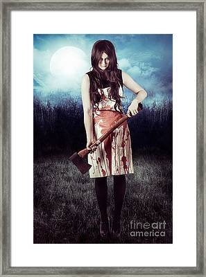 Evil Woman Standing In Dark Field Carrying Axe Framed Print