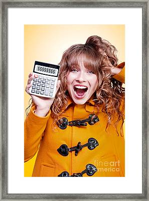 Excited Winter Woman Holding Savings Calculator Framed Print