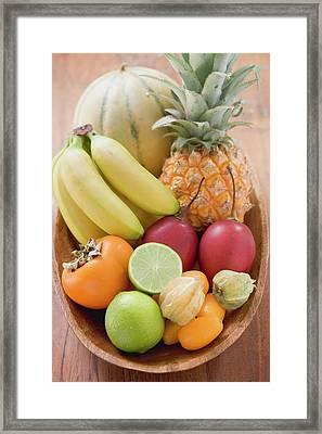 Exotic Fruit And Citrus Fruit In Wooden Bowl Framed Print