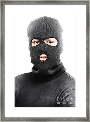 Face Of A Burglar Wearing A Ski Mask Or Balaclava Framed Print by Jorgo Photography - Wall Art Gallery