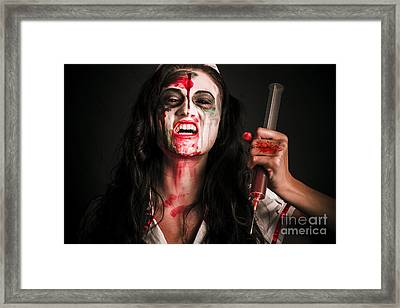 Face Of A Creepy Nurse Making Stab With Big Needle Framed Print by Jorgo Photography - Wall Art Gallery