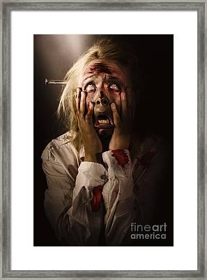 Facing Dark Horror. Dying Zombie Screaming In Fear Framed Print