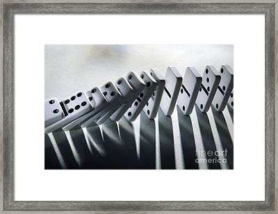 Falling Dominoes Framed Print by Victor de Schwanberg
