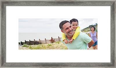Father Giving Daughter Piggyback Framed Print