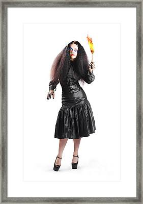 Female Jester Holding Lit Fire Torch Framed Print by Jorgo Photography - Wall Art Gallery