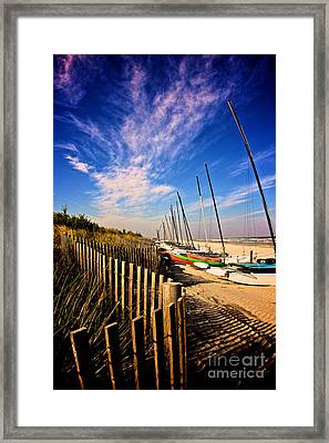 Fence And Sailboats Framed Print