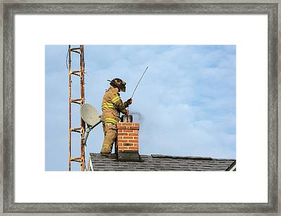 Firefighter Fighting A Chimney Fire Framed Print by Jim West