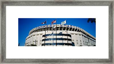 Flags In Front Of A Stadium, Yankee Framed Print by Panoramic Images