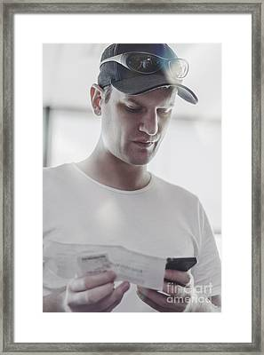 Flight Passenger At Airport Check-in With Mobile Framed Print by Jorgo Photography - Wall Art Gallery