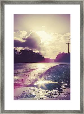 Florescent Road Sunset. Passing Storm Reflection Framed Print