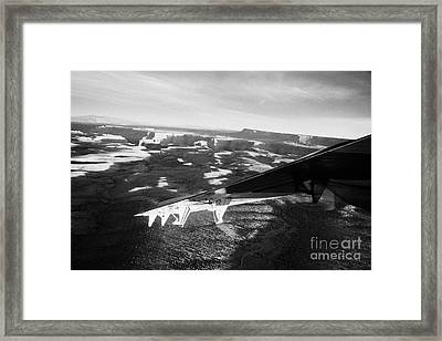 flying over land approaches to the rim of the grand canyon Arizona USA Framed Print by Joe Fox