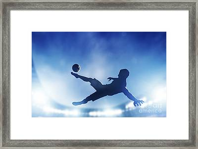 Football Soccer Match A Player Shooting On Goal Framed Print by Michal Bednarek