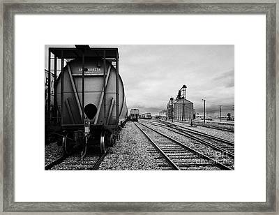 freight grain trucks on canadian pacific railway at assiniboia depot Saskatchewan Canada Framed Print by Joe Fox