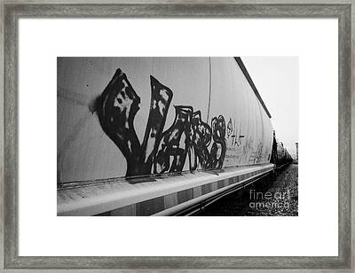 freight grain trucks on canadian pacific railway through assiniboia Saskatchewan Canada Framed Print by Joe Fox