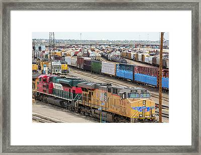 Freight Trains At A Rail Yard Framed Print by Jim West