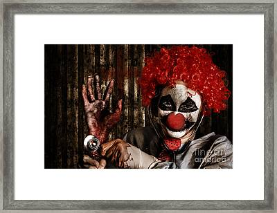 Frightening Clown Doctor Holding Amputated Hand  Framed Print by Jorgo Photography - Wall Art Gallery