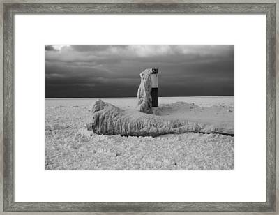 Frozen Lighthouse In Michigan Framed Print by Dan Sproul