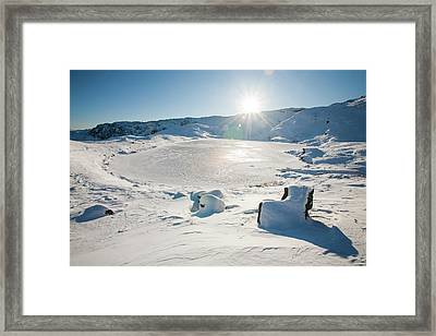 Frozen Tarn Framed Print by Ashley Cooper