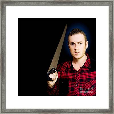 Frustrated Angry Man Brandishing A Saw Framed Print by Jorgo Photography - Wall Art Gallery