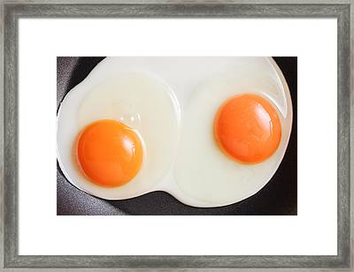 Frying Eggs Framed Print by Tom Gowanlock