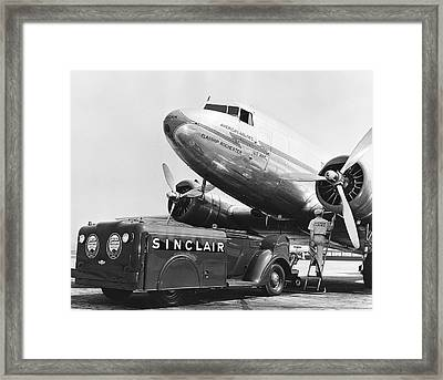 Fueling A Dc-3 Airliner Framed Print by Underwood Archives