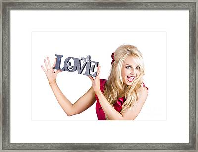 Fun Blonde Woman With Love Word Sign Framed Print by Jorgo Photography - Wall Art Gallery