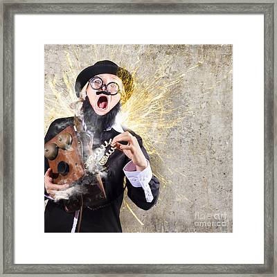 Funny Man Getting Electric Shock From Old Phone Framed Print