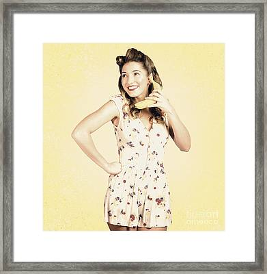 Funny Pin-up Model In Conversation On Banana Phone Framed Print