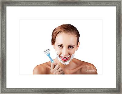 Funny Portrait Of A Woman Shaving Face With Razor Framed Print