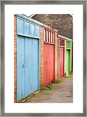 Garage Doors Framed Print by Tom Gowanlock