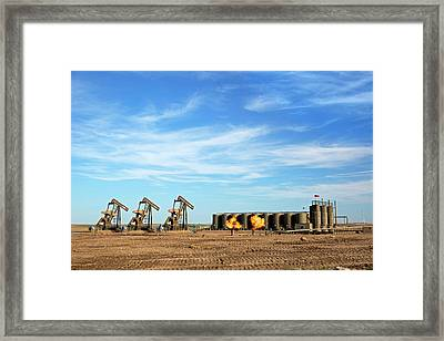 Gas Flares And Pumps At An Oil Field Framed Print by Jim West